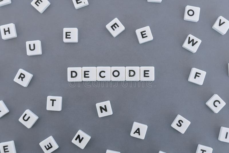 Decode word made of square letter word on grey background stock images