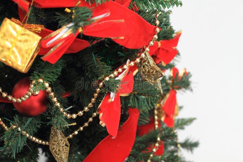 Decolated christmas tree. Christmas tree with white back stock image