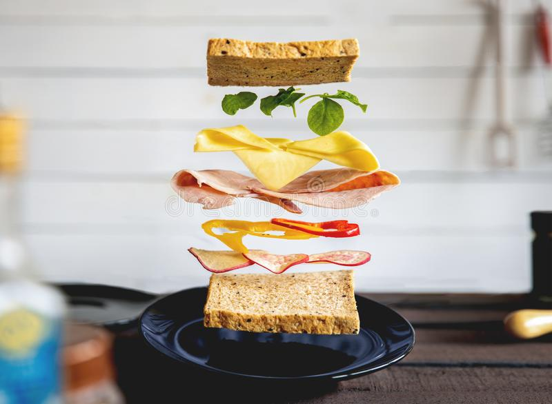 Deconstructed sandwich layers in kitchen stock image
