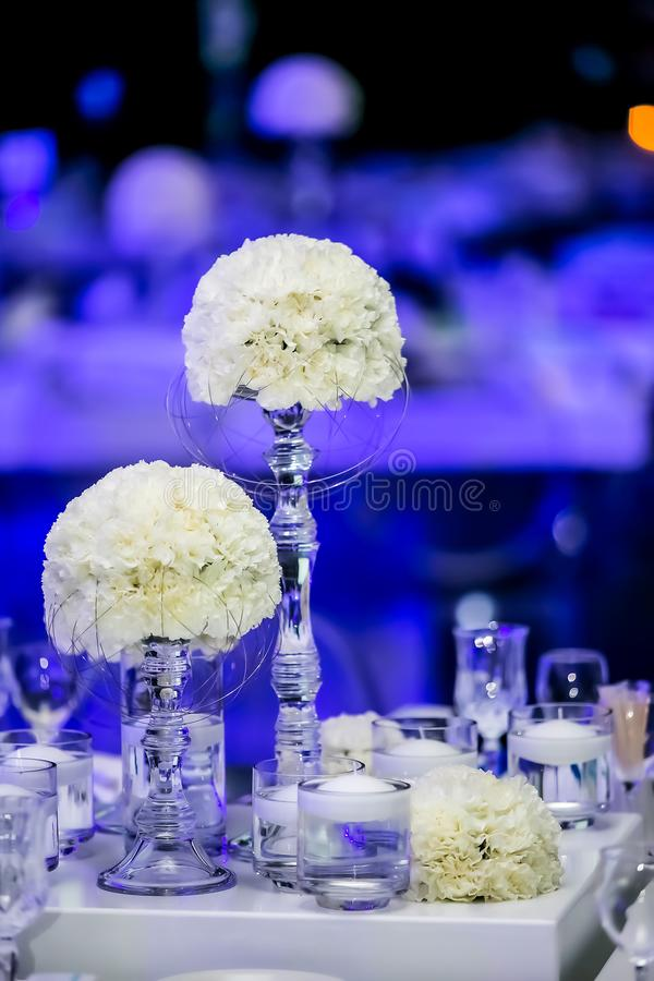 Decor with candles and white flowers for a large corporate party event or Gala Dinner royalty free stock photography