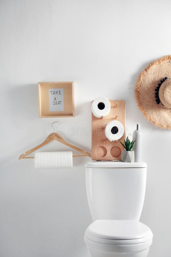 Free Decor Elements, Necessities And Toilet Bowl Near Wall Stock Image - 155557511