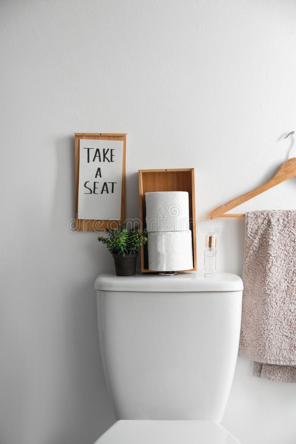 Free Decor Elements, Necessities And Toilet Bowl Near Wall. Bathroom Interior Stock Images - 154520134