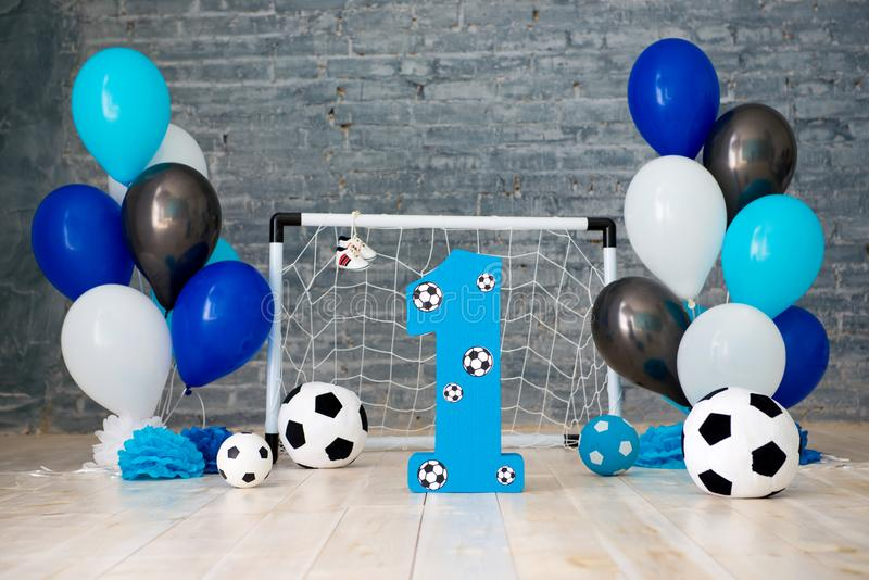 Decor of the first year of football, gates, balls and soccer balls.  royalty free stock photo