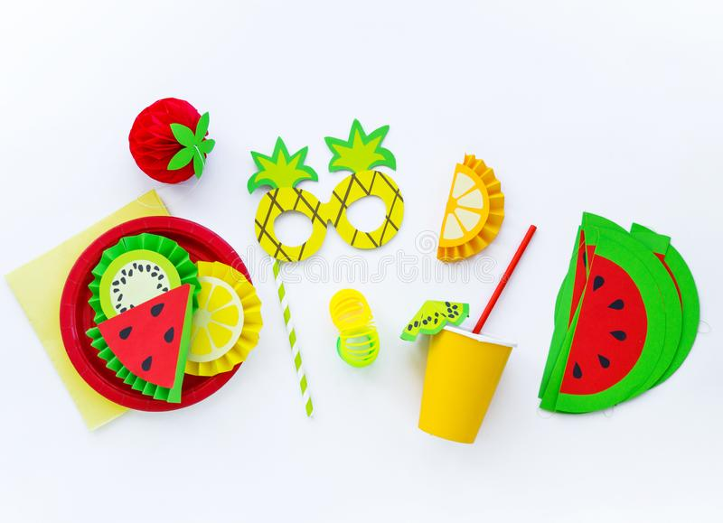 Decor for a holiday of children`s birthday. Fruit party. Cake and sweet candy. Flat lay stock image