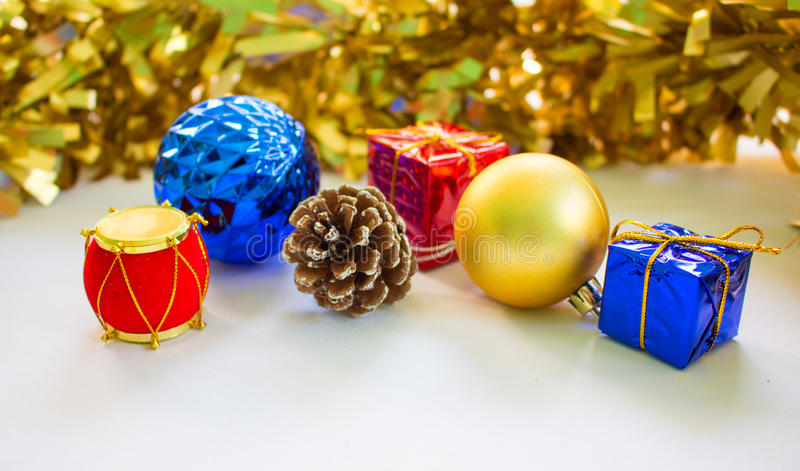Decor objects for Christmas or Chinese New Year. Christmas ornament composition on white background. Blue and golden fir tree balls. Red blue Christmas presents stock photos