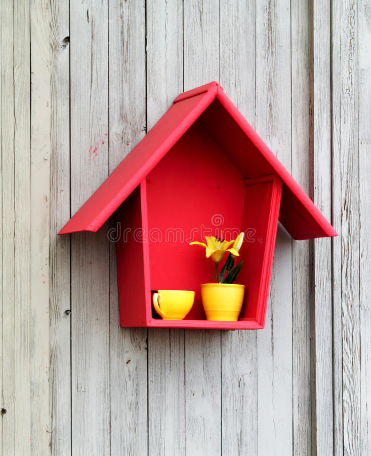 Decor - red house and yellow cup royalty free stock photography