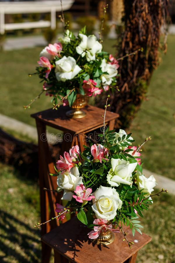Decor for a round wedding arch from branches decorated with flowers royalty free stock image