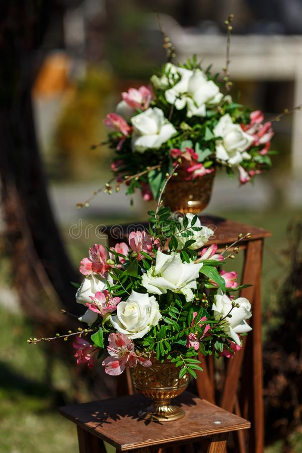Decor for a round wedding arch from branches decorated with flowers stock photography