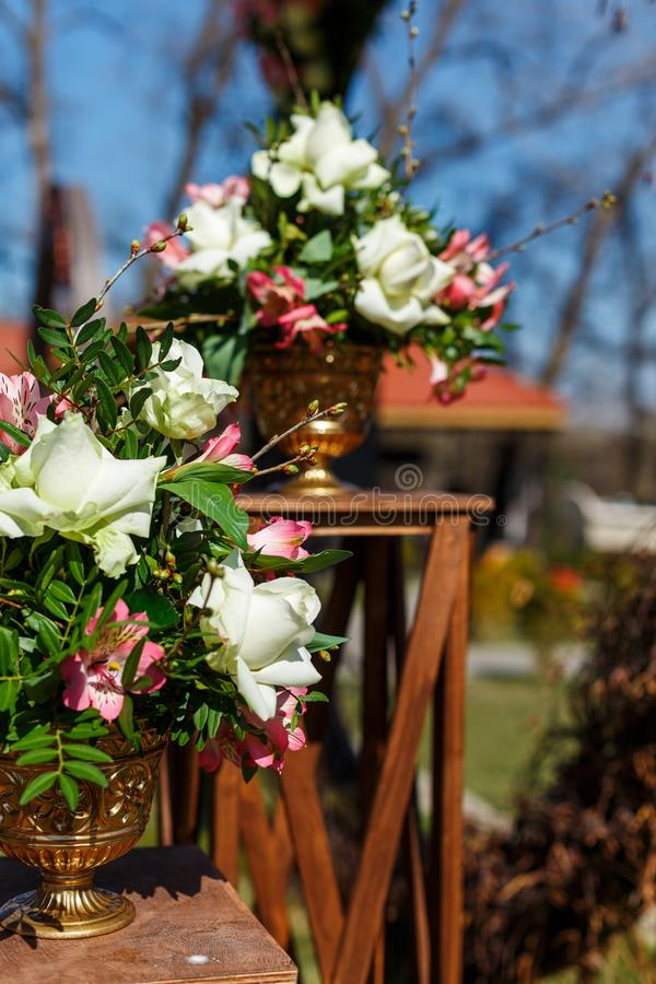Decor for a round wedding arch from branches decorated with flowers royalty free stock photos
