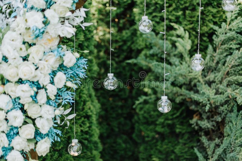 Decor wedding arch ceremony floral glass balls. Decor of the wedding arch for the ceremony with floral decorations and decorative glass balls, element royalty free stock photo