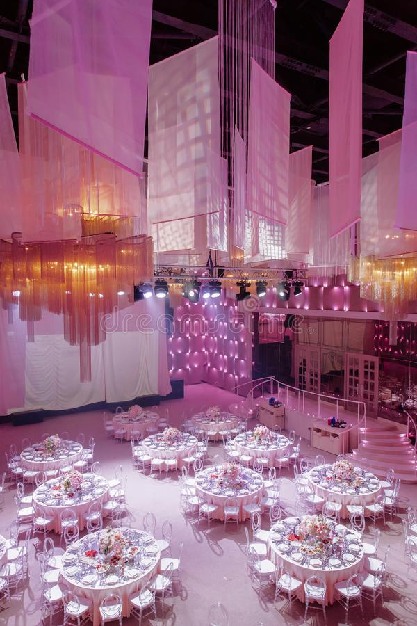The decor of the wedding hall in pink stock photography