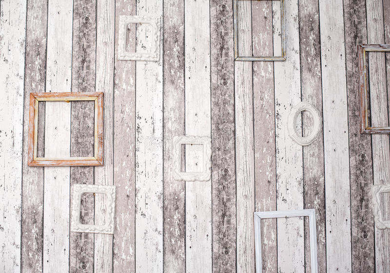 Decor of wooden picture frames on the grunge wall.  royalty free stock images