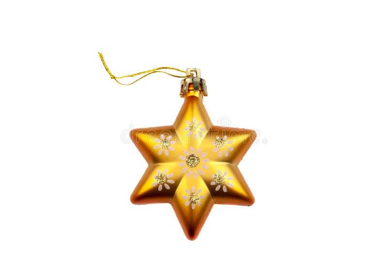 Decoração alaranjada da árvore de Natal da estrela com flores pintadas e o pó do ouro isolado no fundo branco fotografia de stock