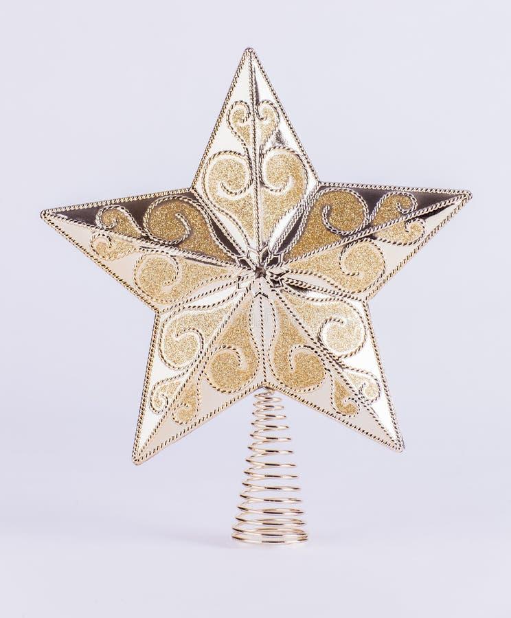Decoração da árvore de Natal da estrela do ouro no fundo branco imagens de stock royalty free