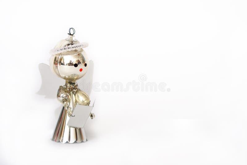 Decoração do Natal, anjo de prata no fundo branco fotos de stock royalty free