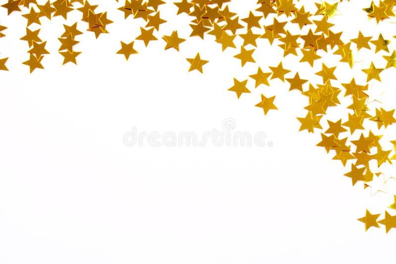 Decoração do Natal de estrelas douradas do confetti fotos de stock royalty free