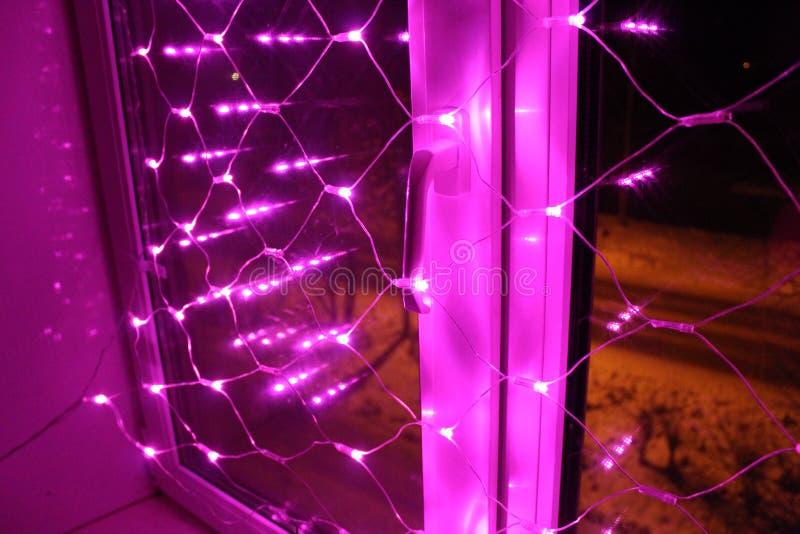 Decoração do Natal para as janelas - luzes cor-de-rosa fotografia de stock royalty free