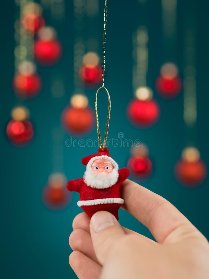 Decoração Handheld do Natal de Santa do brinquedo imagens de stock royalty free