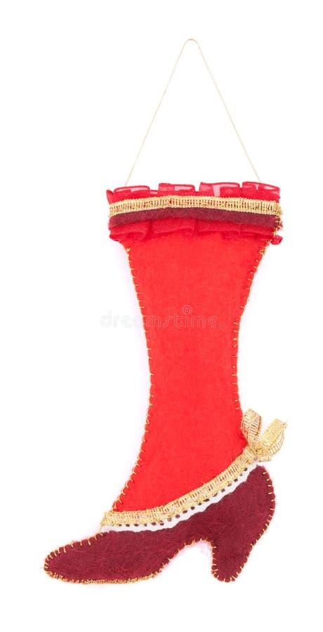 Decorações do Natal da bota de feltro isoladas no fundo branco imagem de stock