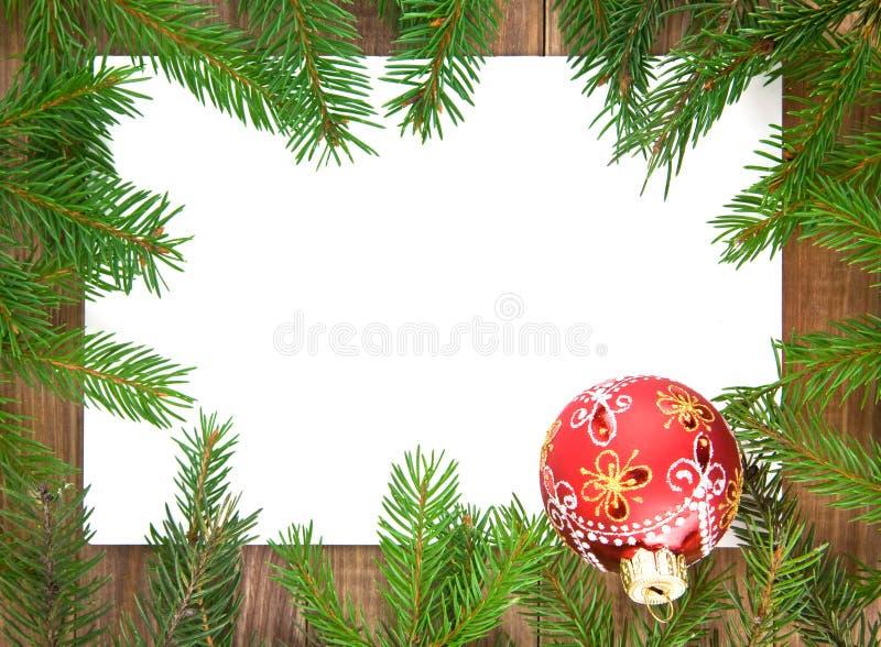 Decorações do Natal e ramos do abeto fotos de stock