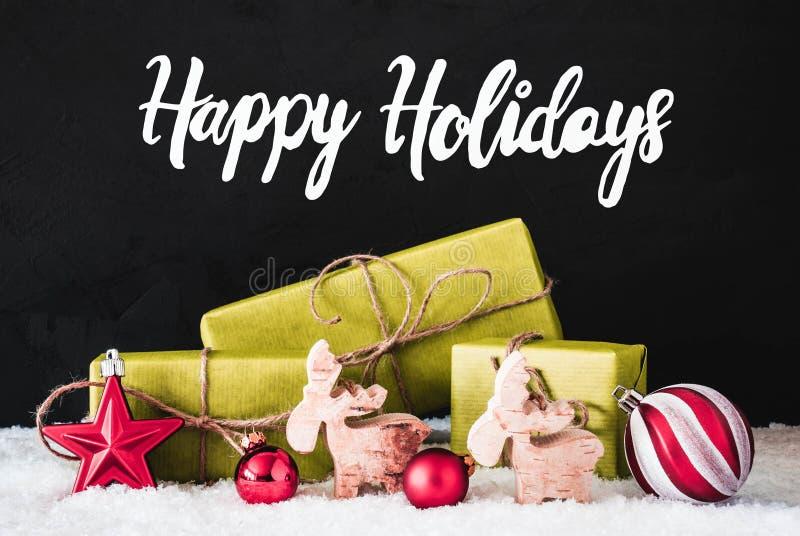 Decoración de la Navidad, caligrafía buenas fiestas, nieve, fondo negro fotografía de archivo libre de regalías