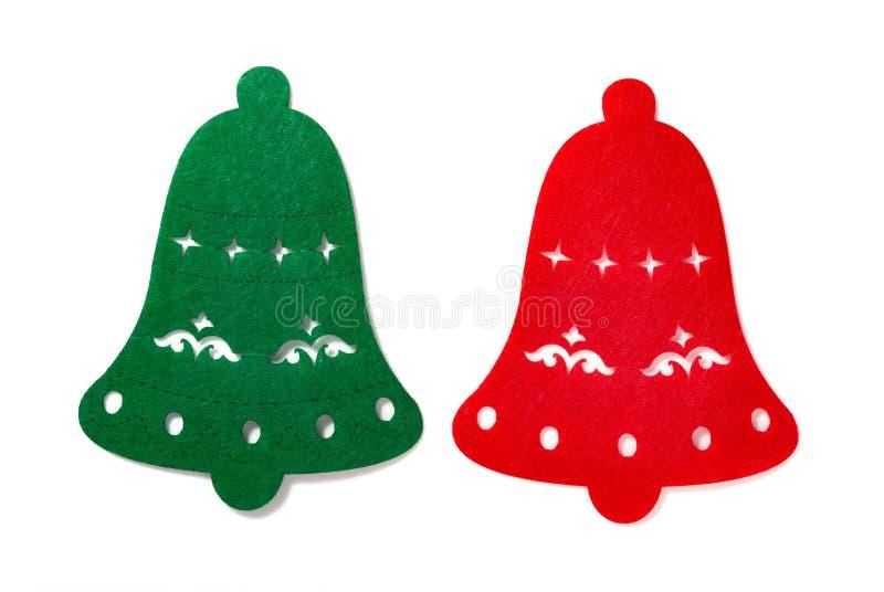 Decoración de la Navidad de campanas planas verdes y rojas en blanco fotos de archivo