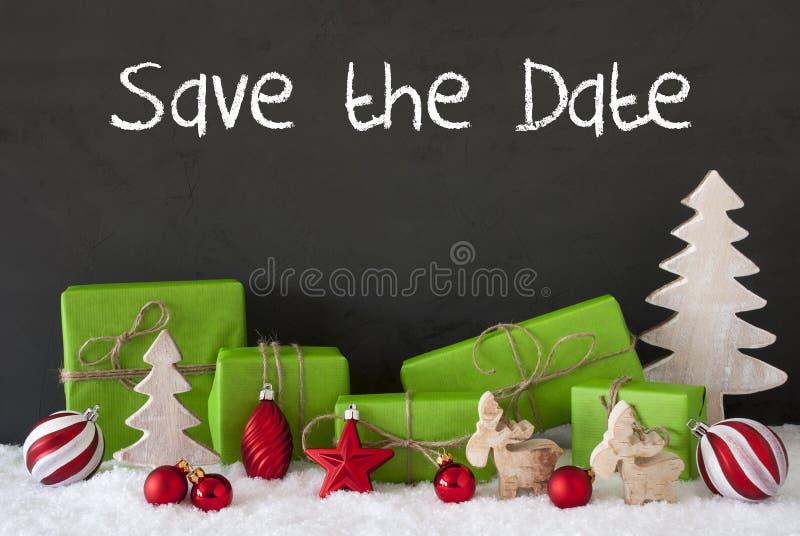 Decoración de la Navidad, cemento, nieve, reserva inglesa del texto la fecha fotos de archivo libres de regalías