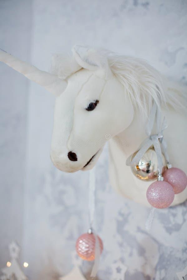 Decoración de la Navidad con la cabeza del unicornio fotos de archivo libres de regalías