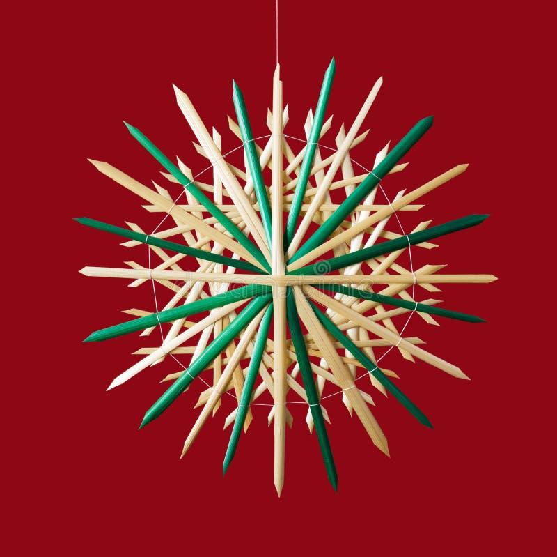 Decoración de la Navidad de la estrella de la paja sobre rojo libre illustration