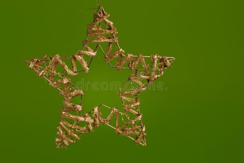 Decoración de la Navidad, estrella de oro imagenes de archivo