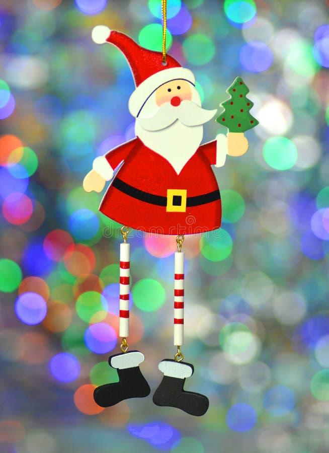 Decoración de la Navidad, Papá Noel en fondo colorido del bokeh imagen de archivo libre de regalías