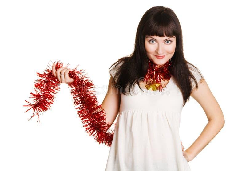 Decoración hermosa joven de la Navidad de la explotación agrícola de la mujer imagen de archivo