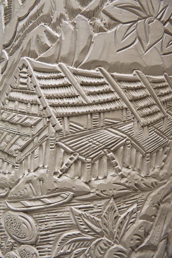 Decoración tribal tradicional en el caolín crudo, Kuching, Malasia de los motivos del tatuaje foto de archivo libre de regalías