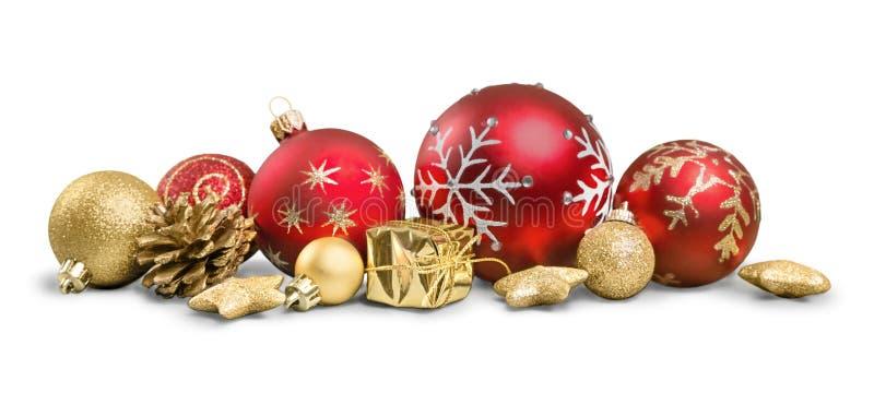 Decoraciones de la Navidad con las chucherías aisladas encendido foto de archivo libre de regalías