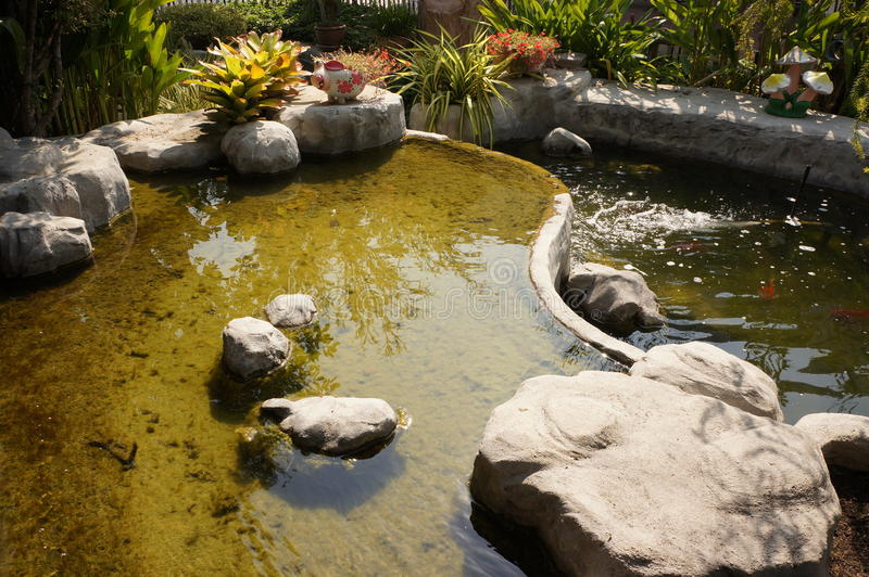 Decorate stone and pond in Ayutthaya royalty free stock image
