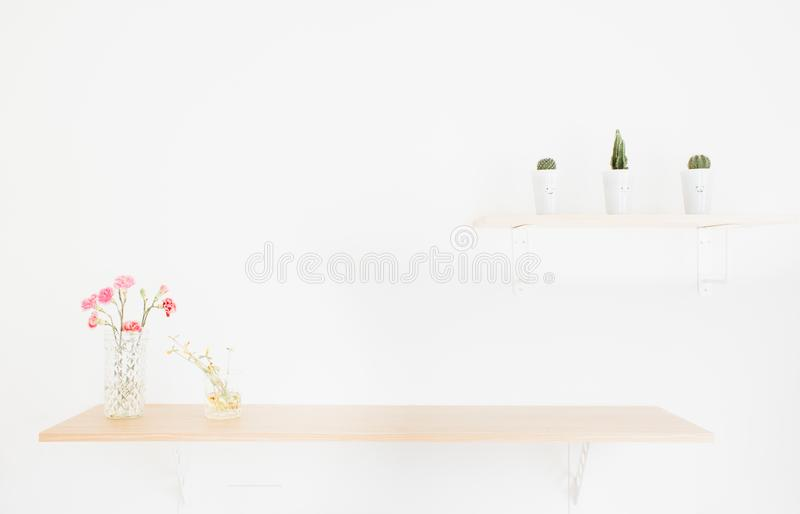 Decorate wood shelf with flowers. Decorate wood shelf with cactus and flowers on wood table royalty free stock images