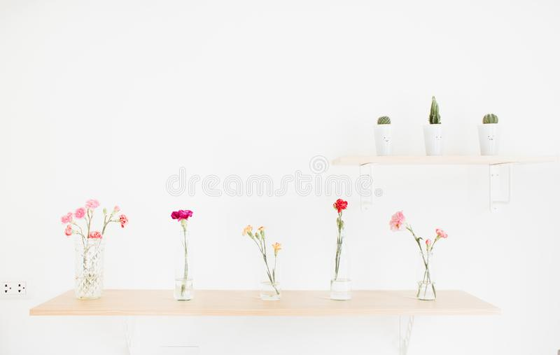 Decorate wood shelf with flowers. Decorate wood shelf with plant and flowers on wood table stock photography