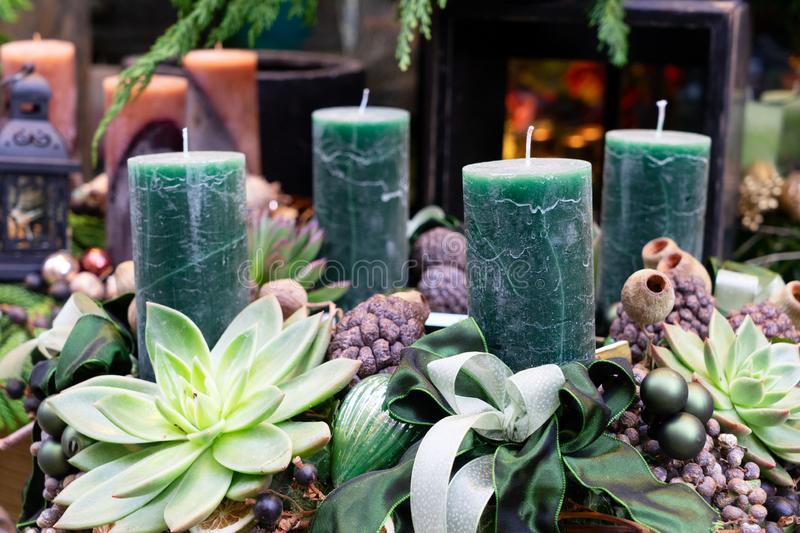 Decorated advent candles. Wreath with succelemt natural decorations stock image