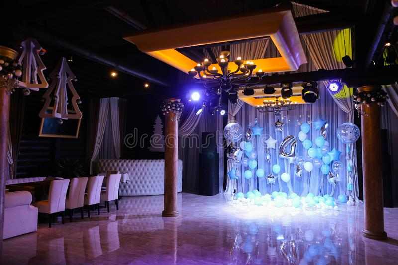 Decorated amazing scene for birthday party with blue balloons and number 4. royalty free stock photo