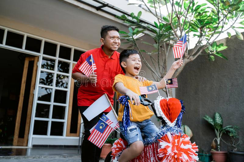 Decorated bicycle and malaysia flag for independence day celebration royalty free stock images