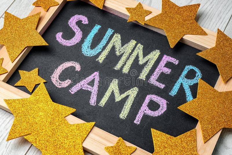Decorated blackboard with text SUMMER CAMP stock image