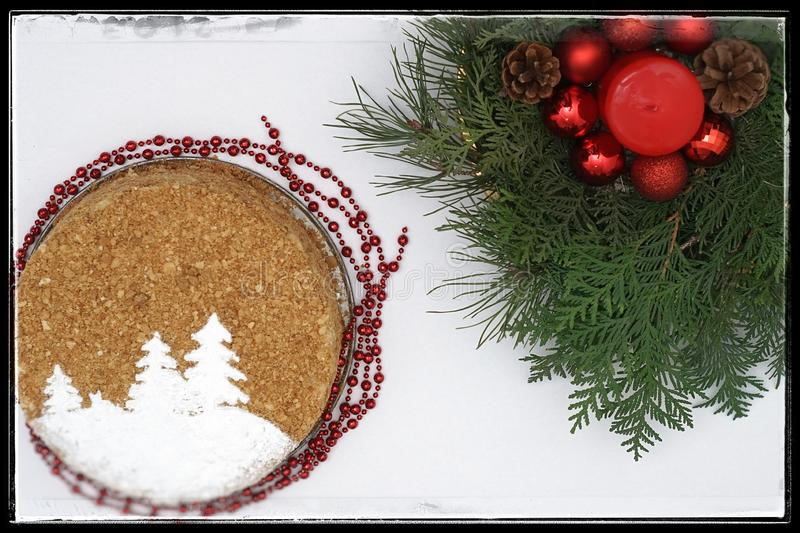 New Year`s cake with Christmas tree branches stock photo