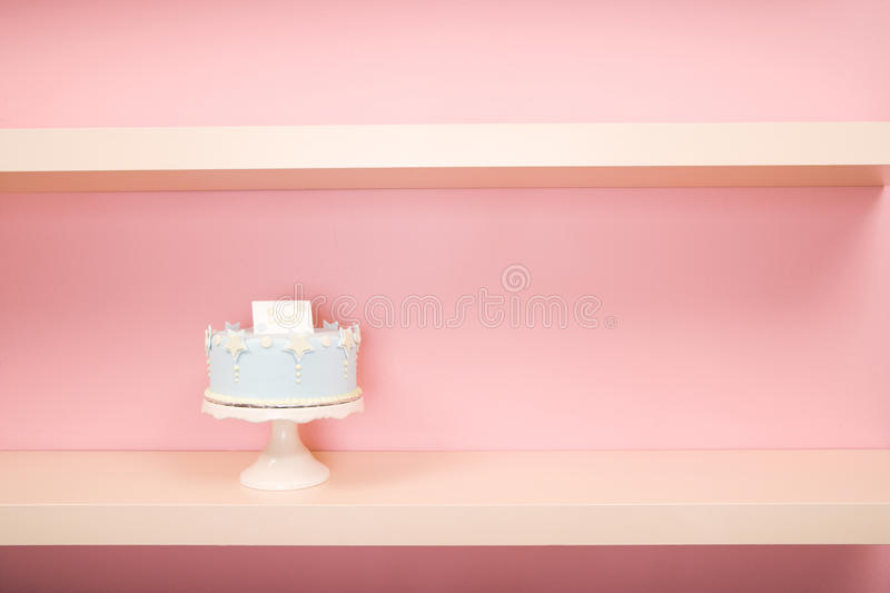 Decorated Cake on Pink Shelf stock images