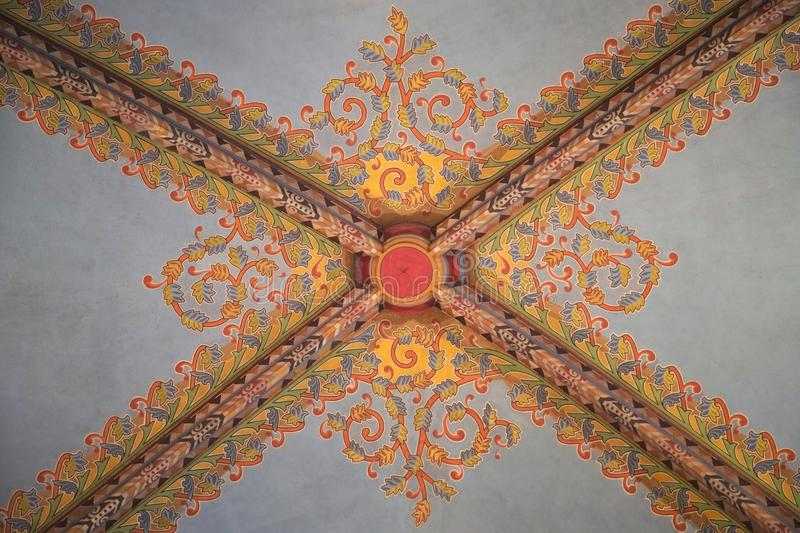Decorated ceiling. The ceiling of a church decorated in colourful intricate geometric patterns