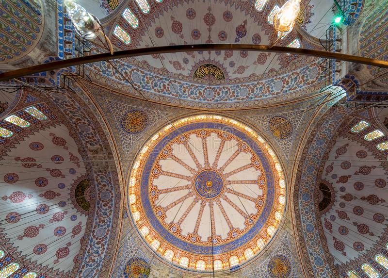 Decorated ceiling at Sultan Ahmed Mosque - Blue Mosque - Istanbul, Turkey. Decorated ceiling at Sultan Ahmed Mosque - Blue Mosque - showing the main big dome stock photography