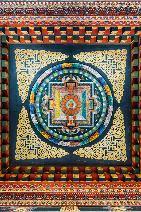 Decorated ceiling that tell about Buddha story in Bhutanese art inside The Royal Bhutanese Monastery in Bodh Gaya, Bihar, India stock images