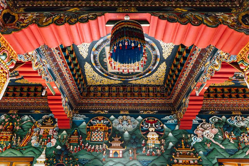 Decorated ceiling that tell about Buddha story in Bhutanese art inside The Royal Bhutanese Monastery in Bodh Gaya, Bihar, India.  stock photography