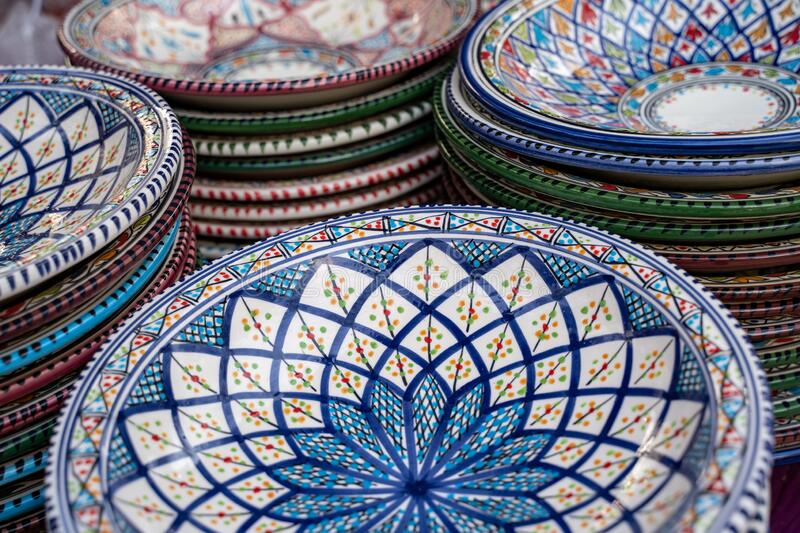 Decorated ceramic bowls and plates on display at the Surajkund Crafts Mela in Faridabad India - selective focus.  stock photography