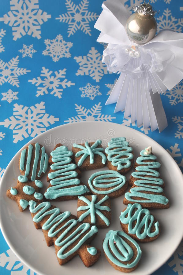 Download Decorated Christmas Honey Cookies On Winter Background With Snowflakes Stock Photo - Image: 83724056