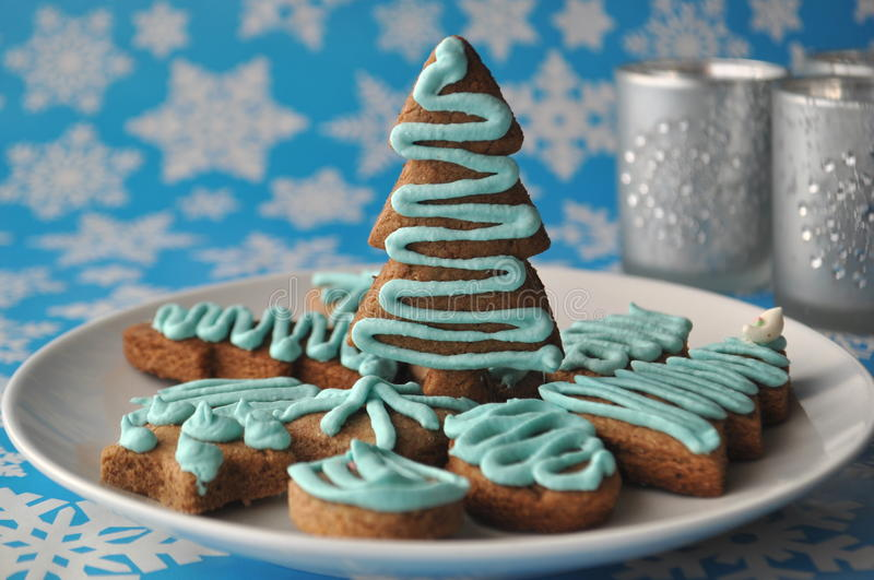 Download Decorated Christmas Honey Cookies On Winter Background With Snowflakes Stock Photo - Image: 83723463